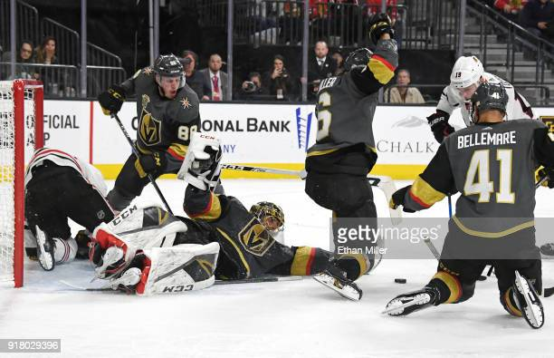 MarcAndre Fleury of the Vegas Golden Knights continues to defend the net with teammates Nate Schmidt Colin Miller and PierreEdouard Bellemare after...
