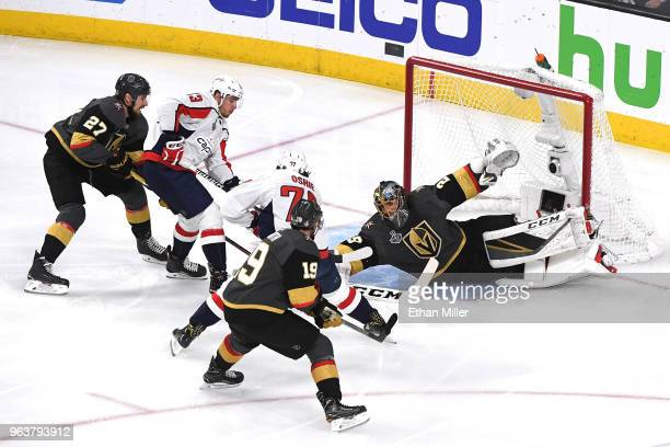 MarcAndre Fleury of the Vegas Golden Knights defends a shot from TJ Oshie of the Washington Capitals during the first period in Game Two of the 2018...
