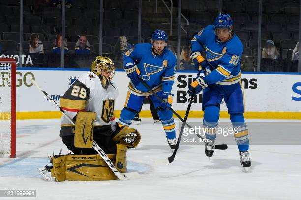 Marc-Andre Fleury of the Vegas Golden Knights defends the net against Brayden Schenn and Vladimir Tarasenko of the St. Louis Blues on March 13, 2021...