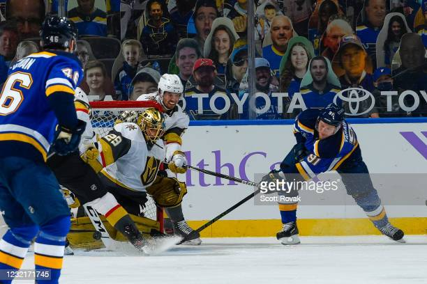 Marc-Andre Fleury of the Vegas Golden Knights defends the net against Vladimir Tarasenko of the St. Louis Blues on April 7, 2021 at the Enterprise...