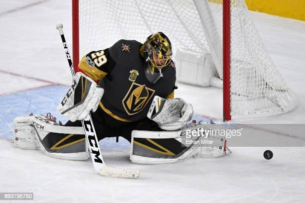 MarcAndre Fleury of the Vegas Golden Knights deflects a Pittsburgh Penguins shot in the third period of their game at TMobile Arena on December 14...