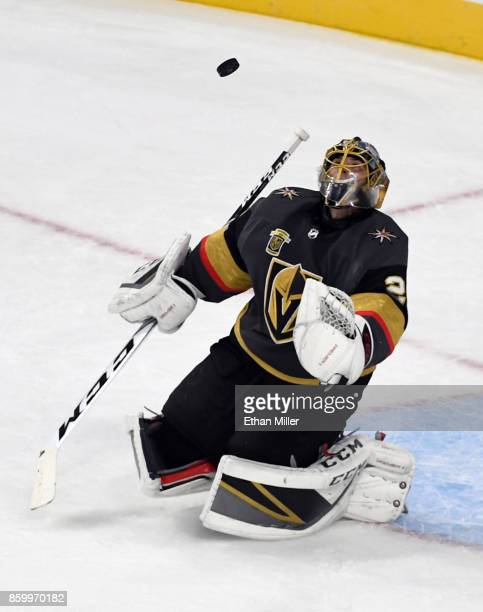 MarcAndre Fleury of the Vegas Golden Knights deflects an Arizona Coyotes shot during the first period of the Golden Knights' inaugural regularseason...