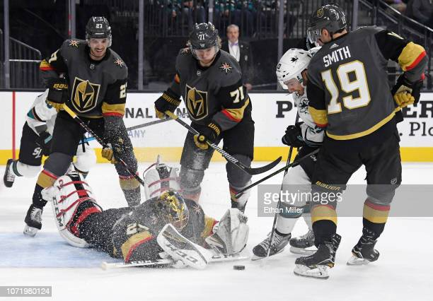 MarcAndre Fleury of the Vegas Golden Knights dives to block a shot by Barclay Goodrow of the San Jose Sharks in the first period of their game at...