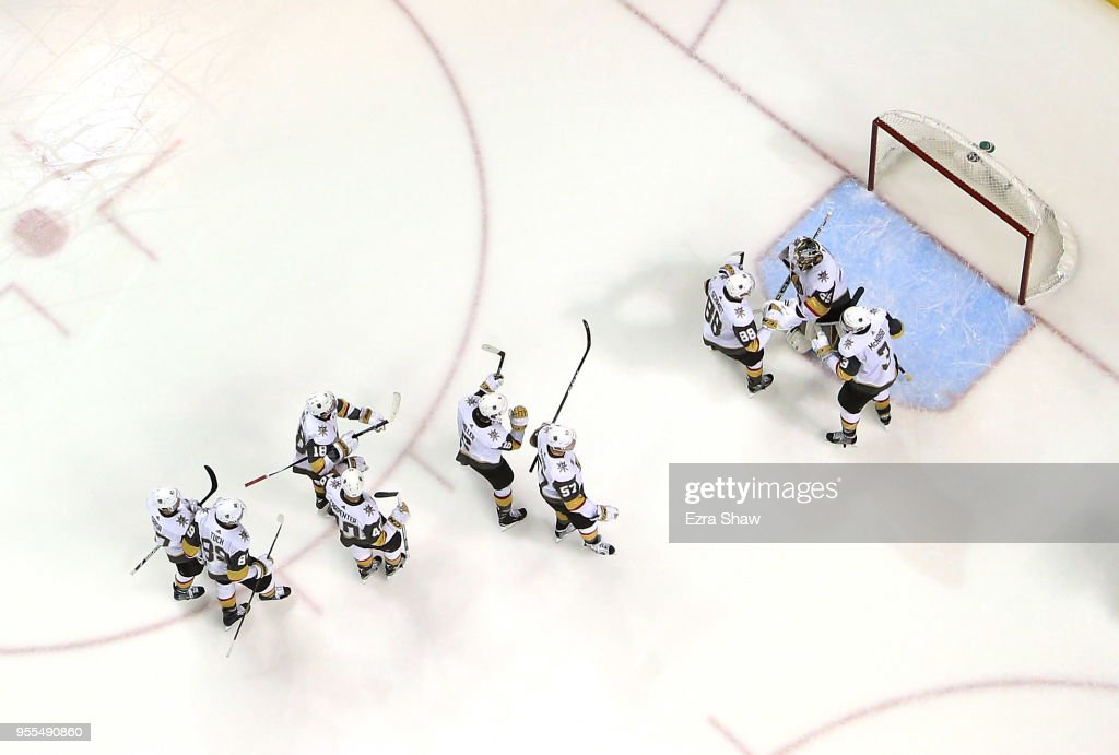 Marc-Andre Fleury #29 of the Vegas Golden Knights is congratulated by teammates after he shut out the San Jose Sharks to win Game Six of the Western Conference Second Round during the 2018 NHL Stanley Cup Playoffs at SAP Center on May 6, 2018 in San Jose, California.