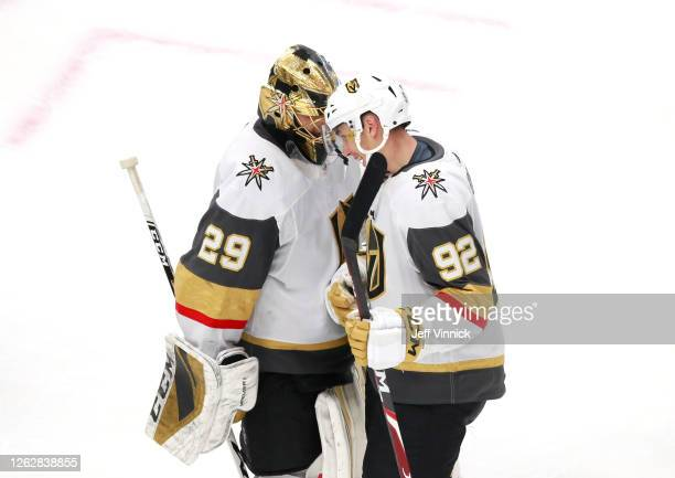 Marc-Andre Fleury of the Vegas Golden Knights is congratulated by teammate Tomas Nosek after the 4-1 win over the Arizona Coyotes during an...