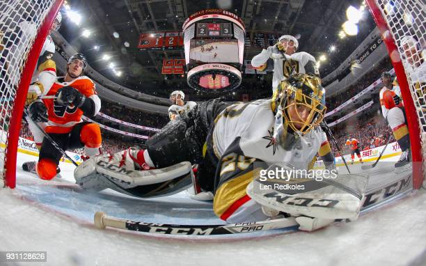 MarcAndre Fleury of the Vegas Golden Knights looks back into his net after saving a scoring chance by Travis Konecny of the Philadelphia Flyers on...