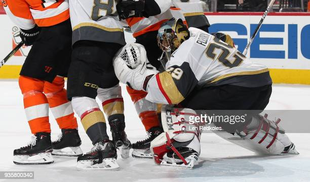 MarcAndre Fleury of the Vegas Golden Knights looks through traffic in his crease against the Philadelphia Flyers on March 12 2018 at the Wells Fargo...