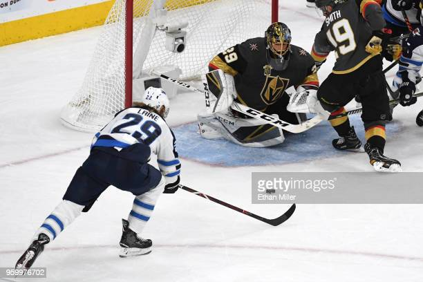 MarcAndre Fleury of the Vegas Golden Knights makes a diving save against Patrik Laine of the Winnipeg Jets during the second period in Game Four of...
