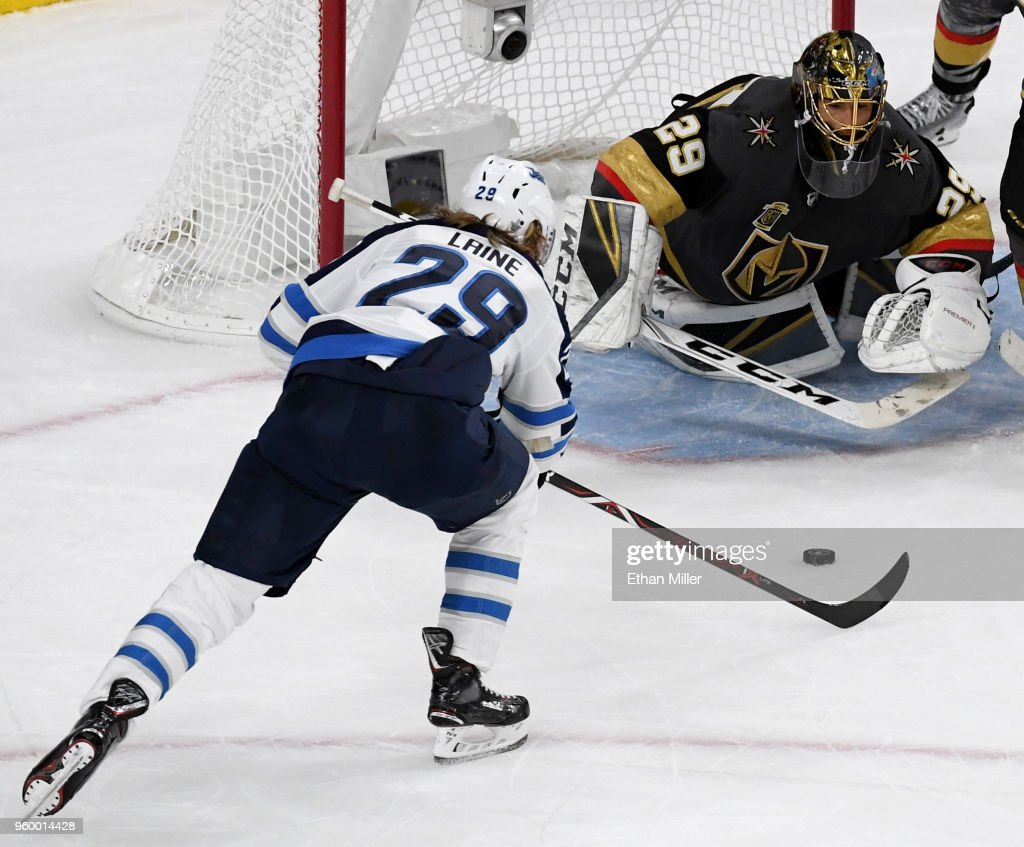Marc-Andre Fleury #29 of the Vegas Golden Knights makes a diving save against Patrik Laine #29 of the Winnipeg Jets during the second period Game Four of the Western Conference Finals during the 2018 NHL Stanley Cup Playoffs at T-Mobile Arena on May 18, 2018 in Las Vegas, Nevada. The Golden Knights won 3-2.