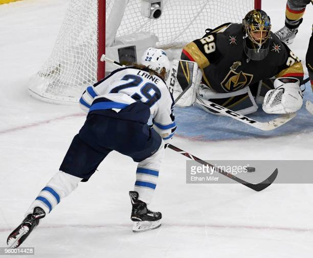 Marc-Andre Fleury of the Vegas Golden Knights makes a diving save against Patrik Laine of the Winnipeg Jets during the second period Game Four of the...