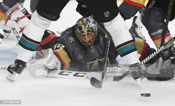 MarcAndre Fleury of the Vegas Golden Knights makes a diving save against the San Jose Sharks in the first period of their game at TMobile Arena on...
