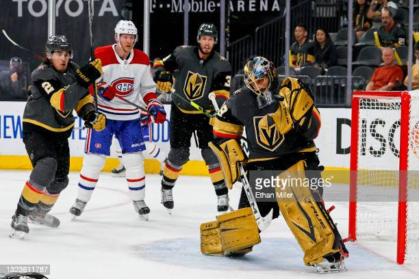 Marc-Andre Fleury of the Vegas Golden Knights makes a glove save as Zach Whitecloud of the Golden Knights, Corey Perry of the Montreal Canadiens and...