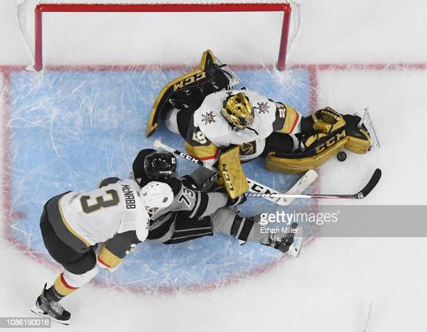 Marc-Andre Fleury of the Vegas Golden Knights makes a kick save on a shot by Tyler Toffoli of the Los Angeles Kings as Brayden McNabb of the Golden...