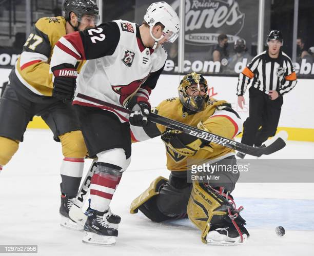 Marc-Andre Fleury of the Vegas Golden Knights makes a save against Johan Larsson of the Arizona Coyotes in the first period of their game at T-Mobile...