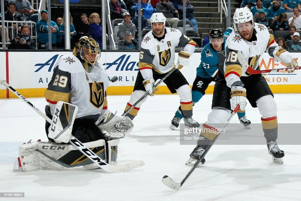 Marc-Andre Fleury #29 of the Vegas Golden Knights makes a save as Deryk Engelland #5 and James Neal #18 of the Vegas Golden Knights defend against the San Jose Sharks at SAP Center on February 8, 2018 in San Jose, California.