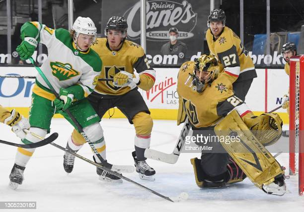 Marc-Andre Fleury of the Vegas Golden Knights makes a save as Kirill Kaprizov of the Minnesota Wild looks for a rebound as Zach Whitecloud of the...