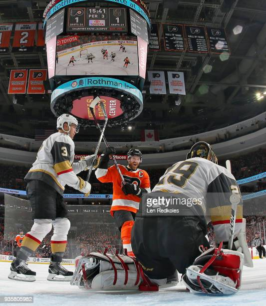 MarcAndre Fleury of the Vegas Golden Knights makes save atop the crease as Brayden McNabb defends Claude Giroux of the Philadelphia Flyers on March...
