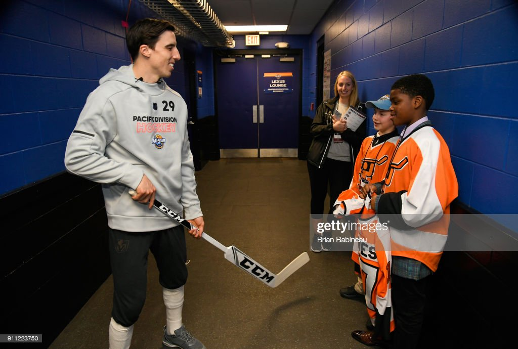 Marc-Andre Fleury #29 of the Vegas Golden Knights meets with Jaydon Jones (R) and Justin Brass prior to the 2018 GEICO NHL All-Star Skills Competition at Amalie Arena on January 27, 2018 in Tampa, Florida.
