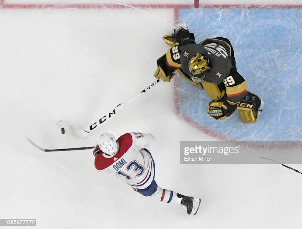 MarcAndre Fleury of the Vegas Golden Knights pokes the puck away from Max Domi of the Montreal Canadiens in overtime of their game at TMobile Arena...