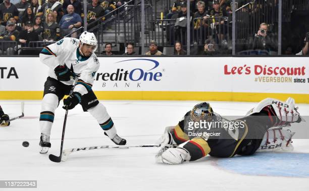 MarcAndre Fleury of the Vegas Golden Knights pokes the puck away from Evander Kane of the San Jose Sharks on a breakaway during the second period in...
