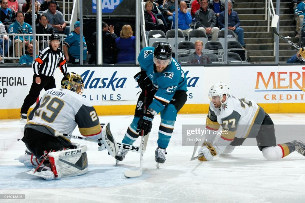 Marc-Andre Fleury #29 of the Vegas Golden Knights protects the net as Brad Hunt #77 of the Vegas Golden Knights defends Barclay Goodrow #23 of the San Jose Sharks at SAP Center on February 8, 2018 in San Jose, California.