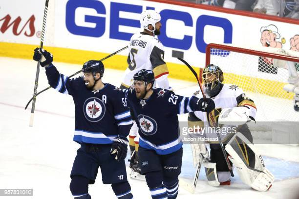 MarcAndre Fleury of the Vegas Golden Knights reacts as Mark Scheifele is congratulated by his teammate Paul Stastny of the Winnipeg Jets after...