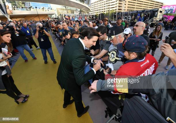 MarcAndre Fleury of the Vegas Golden Knights signs autographs for fans as he arrives at the team's inaugural regularseason home opener against the...