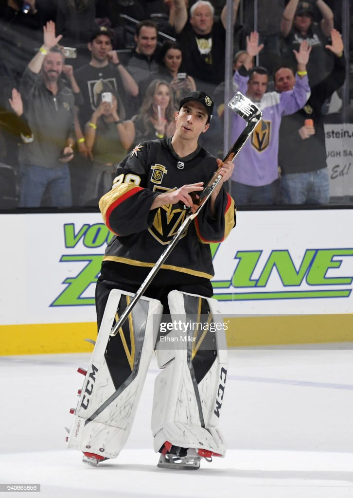 Marc-Andre Fleury #29 of the Vegas Golden Knights skates with a golden stick he received as a special commemoration of his 400th win as an NHL goaltender after the team's game against the San Jose Sharks at T-Mobile Arena on March 31, 2018 in Las Vegas, Nevada. The Golden Knights won the game 3-2 and clinched the Pacific Division title. Fleury won his 400th game on March 12 in a victory over the Philadelphia Flyers.