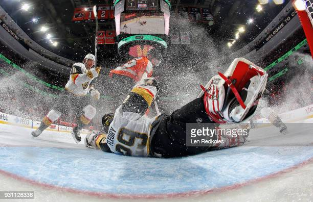 MarcAndre Fleury of the Vegas Golden Knights slides across his crease as Colin Miller defends against Claude Giroux of the Philadelphia Flyers on...
