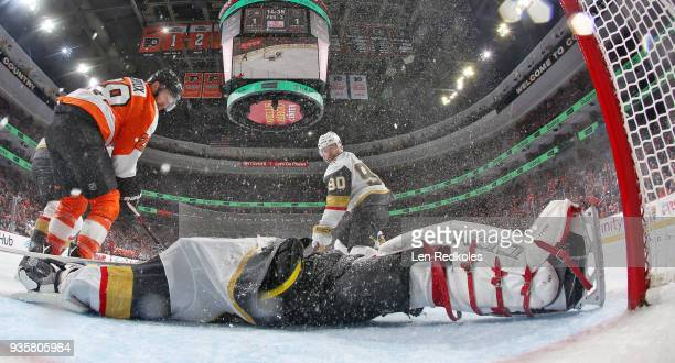 MarcAndre Fleury of the Vegas Golden Knights slides across his crease as Colin Miller and Tomas Tatar defends Claude Giroux of the Philadelphia...