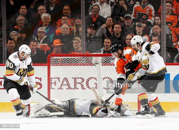 MarcAndre Fleury of the Vegas Golden Knights stops a shot by Claude Giroux of the Philadelphia Flyers in the third period as teammates Tomas Tatar...