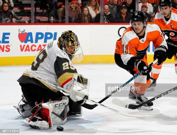 MarcAndre Fleury of the Vegas Golden Knights stops a shot by Travis Konecny of the Philadelphia Flyers in the second period on March 12 2018 at Wells...