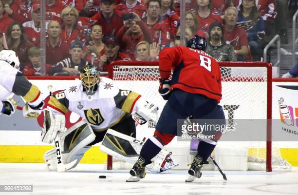 MarcAndre Fleury of the Vegas Golden Knights stops a shot from Alex Ovechkin of the Washington Capitals during the first period in Game Three of the...