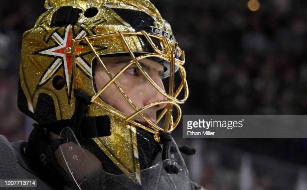 MarcAndre Fleury of the Vegas Golden Knights takes a break during a stop in play in the third period of a game against the Tampa Bay Lightning at...