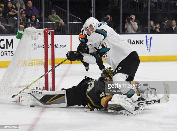 MarcAndre Fleury of the Vegas Golden Knights takes down Joonas Donskoi of the San Jose Sharks in the second overtime period of Game Two of the...