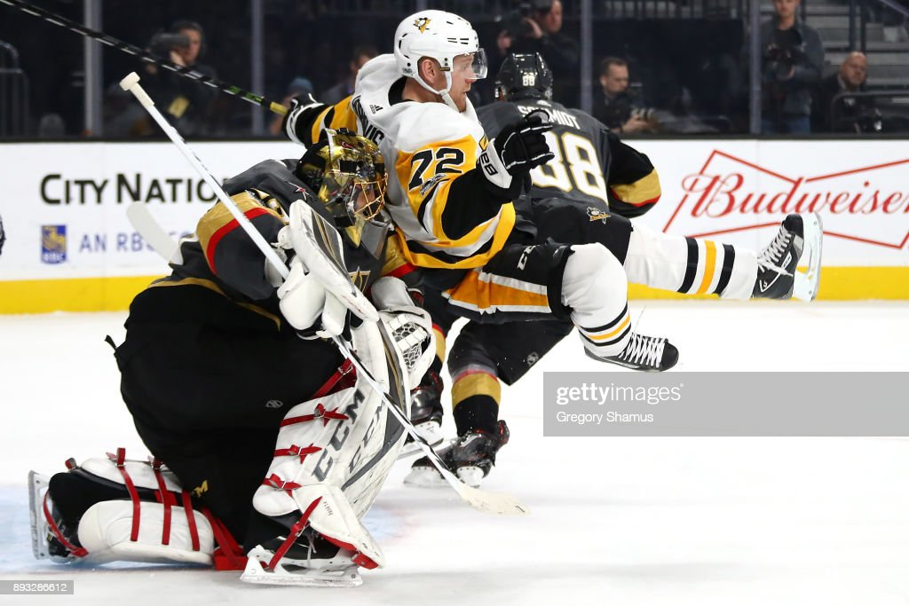 Marc-Andre Fleury #29 of the Vegas Golden Knights takes down Patric Hornqvist #72 of the Pittsburgh Penguins during the first period at T-Mobile Arena on December 14, 2017 in Las Vegas, Nevada.