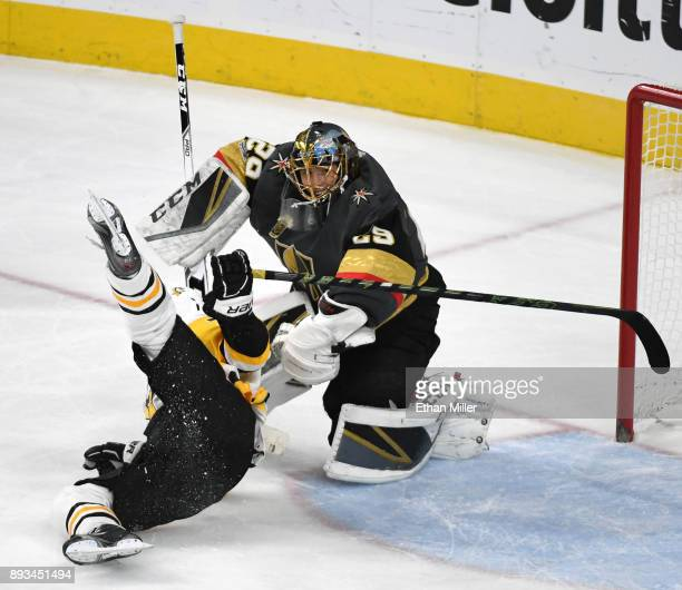 MarcAndre Fleury of the Vegas Golden Knights takes down Patric Hornqvist of the Pittsburgh Penguins in the first period of their game at TMobile...