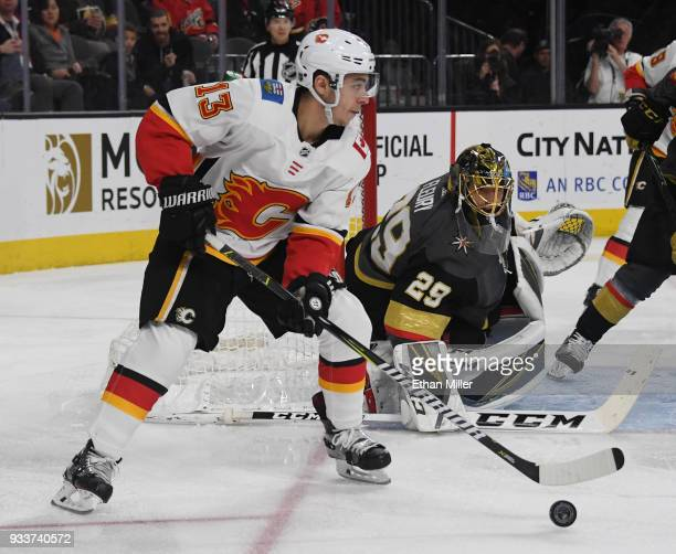 MarcAndre Fleury of the Vegas Golden Knights tends net as Johnny Gaudreau of the Calgary Flames skates with the puck in the first period of their...
