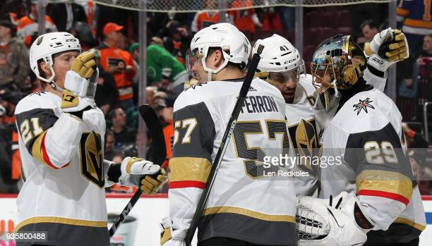 MarcAndre Fleury PierreEdouard Bellemare David Perron and Cody Eakin of the Vegas Golden Knights celebrate after defeating the Philadelphia Flyers 32...