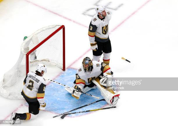Marc-Andre Fleury,Brayden McNabb and Zach Whitecloud of the Vegas Golden Knights react after Taylor Hall of the Arizona Coyotes scored a goal in the...