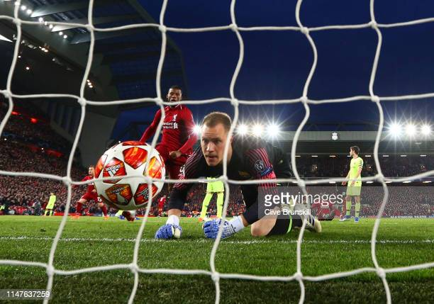 Marc-Andre Ter Stegan of Barcelona fails to stop Georginio Wijnaldum of Liverpool from scoring his team's second goal during the UEFA Champions...