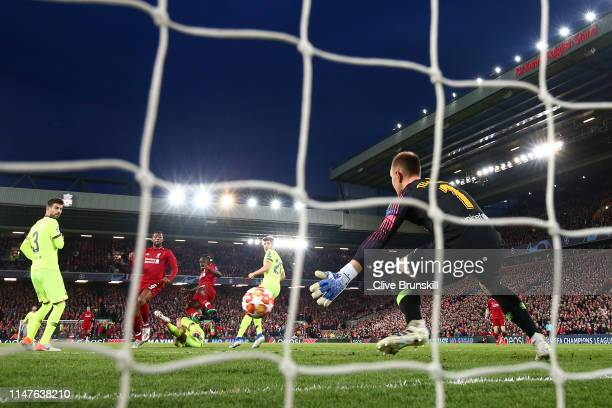 MarcAndre Ter Stegan of Barcelona fails to stop Georginio Wijnaldum of Liverpool from scoring his team's second goal during the UEFA Champions League...