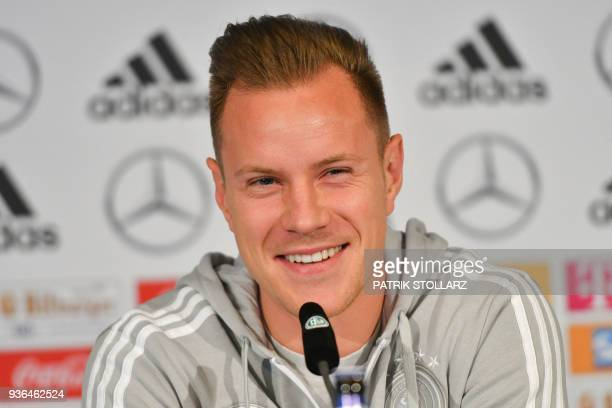 MarcAndre Ter Stegen goalkeeper of the German national football team smiles during a press conference on the eve of the team's international friendly...
