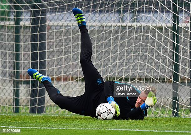 MarcAndre ter Stegen makes a save during a Barcelona training session ahead of their UEFA Champions League quarter final first leg match against...