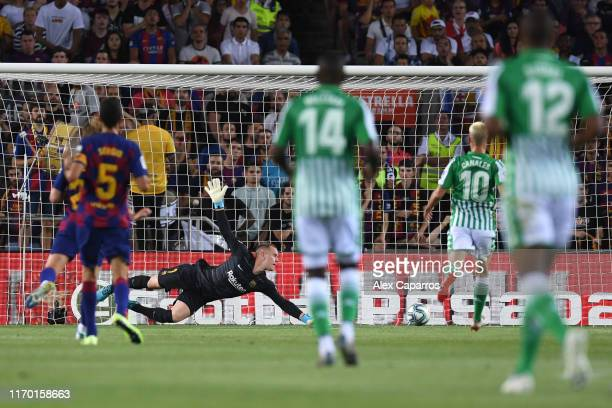 Marc-Andre Ter Stegen of Barcelona attempts to save as Nabil Fekir of Real Betis scores his team's first goal during the Liga match between FC...