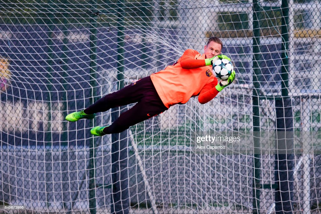 Marc-Andre Ter Stegen of FC Barcelona blocks the ball during a training session ahead of the UEFA Champions League Group D match against Juventus on September 11, 2017 in Barcelona, Spain.