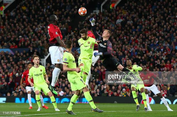 MarcAndre ter Stegen of FC Barcelona punches clear under pressure from Romelu Lukaku of Manchester United during the UEFA Champions League Quarter...