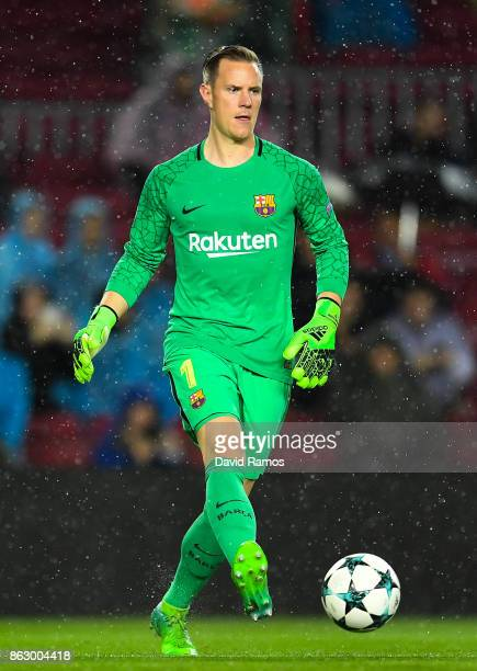MarcAndre ter Stegen of FC Barcelona runs with the ball during the UEFA Champions League group D match between FC Barcelona and Olympiakos Piraeus at...