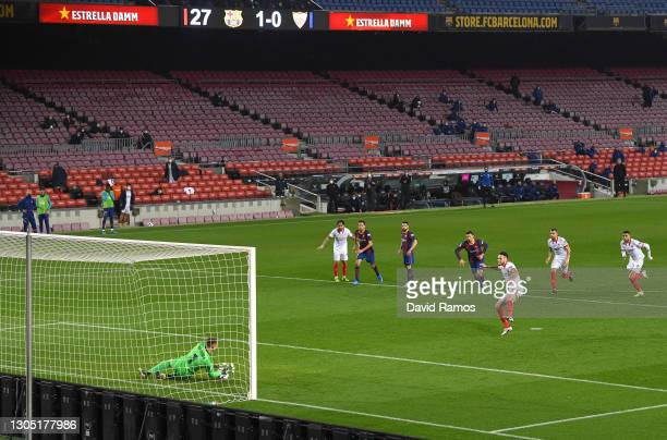 Marc-Andre ter Stegen of FC Barcelona saves a penalty from Lucas Ocampos of Sevilla FC during the Copa del Rey Semi Final Second Leg match between FC...
