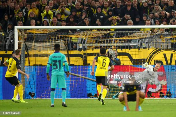 MarcAndre ter Stegen of FC Barcelona saves a penalty from Marco Reus of Borussia Dortmund during the UEFA Champions League group F match between...